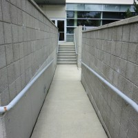 concrete block retaining walls and concrete sidewalk ramp after power washing