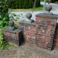 brick fence before pressure washing