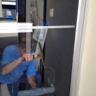 Jim cleaning interior glass lwith perfection - one of our very best window cleaners!