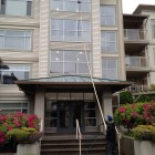 Tucker pole window cleaning in rainy Vancouver