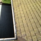 Clean roof & roof valleys and inside gutter troughs