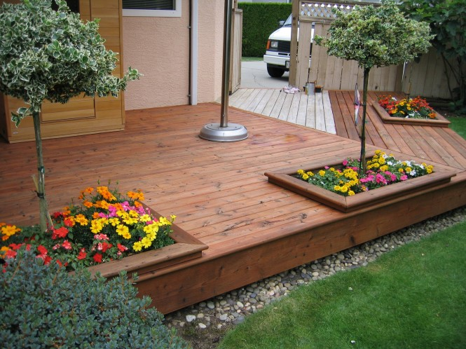 Wooden deck refinishing restoration a glass act for Casas para jardin de pvc