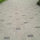 these pavers were power washed then sealed with a transparent, non-slip, penetrating sealer