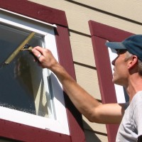 window cleaning with squeegees