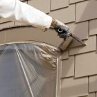 painting window trim and shingle siding