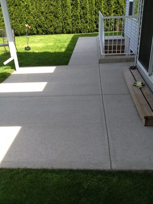 Power washing concrete sealing langley a glass act for Pressure wash concrete patio